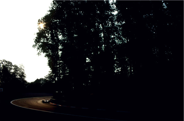 2003 Racing Past. . Exhibition2002 Italian Grand Prix, Monza. Light and shadow from the trees of Europe-s most historic Grand Prix venueWorld Copyright - LAT PhotographicExhibition ref: a096