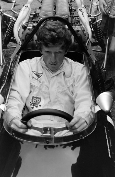 Jochen Rindt sits in the cockpit of his Cooper T86 Maserati.