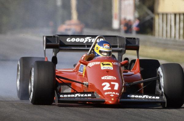Michele Alboreto, Ferrari 126C4, locks up a wheel.