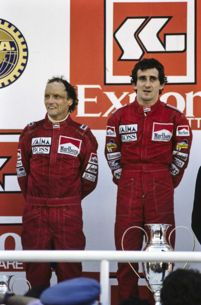Alain Prost, 1st position, and Niki Lauda, 2nd position, on the podium.