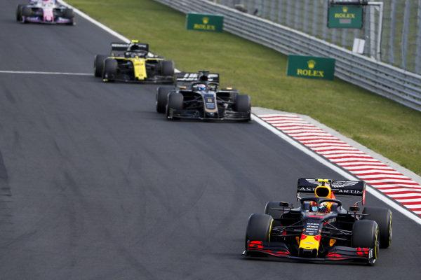 Pierre Gasly, Red Bull Racing RB15, leads Romain Grosjean, Haas VF-19, and Nico Hulkenberg, Renault R.S. 19