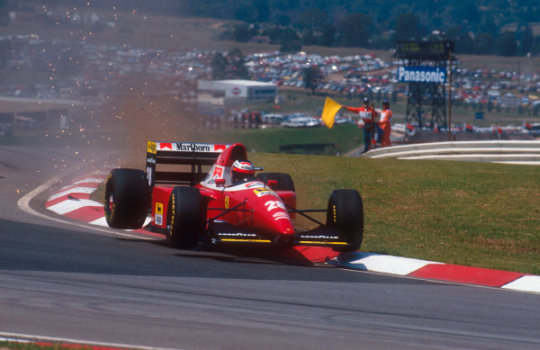 1993 South African Grand Prix.Kyalami, South Africa.12-14 March 1993.Gerhard Berger (Ferrari F93A) rides the kerb on his way to 6th position.Ref-93 SA 06.World Copyright - LAT Photographic