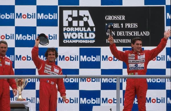 (C) Alain Prost (FRA) 2nd place. (R) Winner Ayrton Senna (BRA). (L) 3rd place Nigel Mansell (GBR)