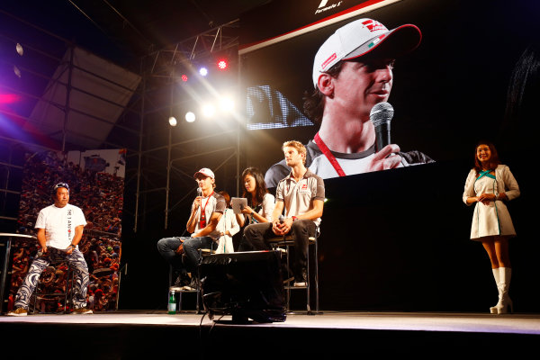 Suzuka Circuit, Japan. Saturday 08 October 2016. Esteban Gutierrez, Haas F1, and Romain Grosjean, Haas F1, at a fan event. World Copyright: Andy Hone/LAT Photographic ref: Digital Image _ONZ4784
