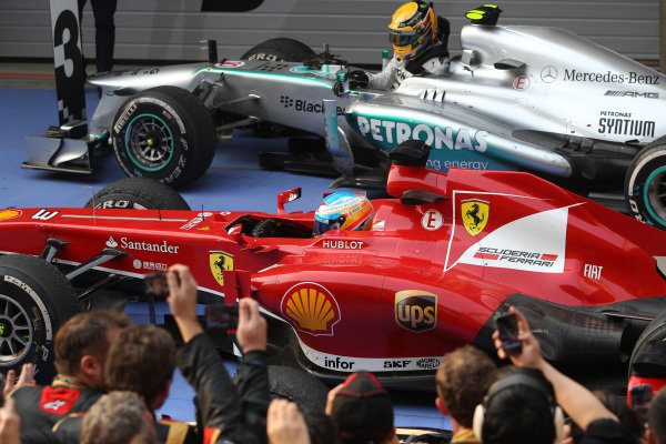 Race winner Fernando Alonso (ESP) Ferrari F138, celebrates in parc ferme as third place Lewis Hamilton (GBR) Mercedes AMG F1 W04 gets out of his car. Formula One World Championship, Rd3, Chinese Grand Prix, Race Day, Shanghai, China, Sunday 14 April 2013. BEST IMAGE