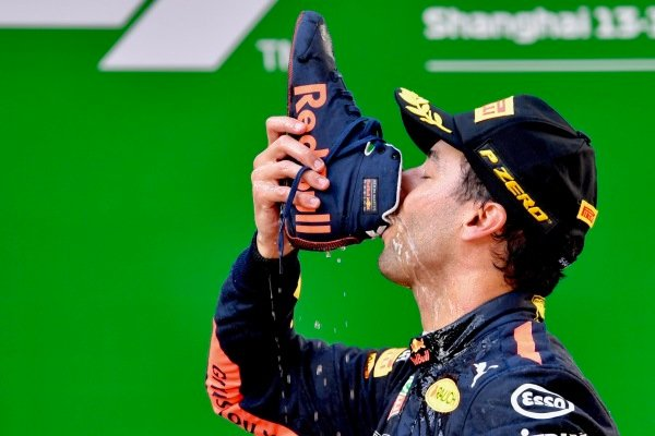 Race winner Daniel Ricciardo (AUS) Red Bull Racing celebrates on the podium with a shuey