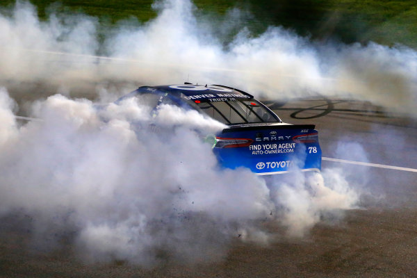 Monster Energy NASCAR Cup Series Go Bowling 400 Kansas Speedway, Kansas City, KS USA Saturday 13 May 2017 Martin Truex Jr, Furniture Row Racing, Auto-Owners Insurance Toyota Camry celebrates his win with a burnout  World Copyright: Russell LaBounty LAT Images ref: Digital Image 17KAN1rl_5787