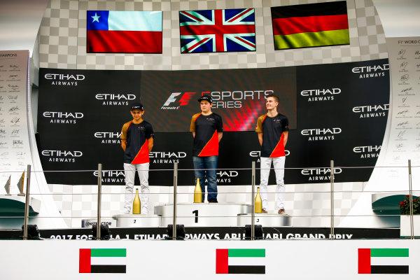 Yas Marina Circuit, Abu Dhabi, United Arab Emirates. Sunday 26 November 2017. Fabrizio Denoso Delgado, champion Brendon Leigh, and Sven Zurner on the E-Sports podium. World Copyright: Andy Hone/LAT Images  ref: Digital Image _ONY3029