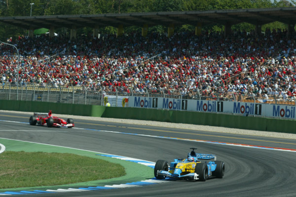 2003 German Grand Prix - Sunday Race, Hockenheim, Germany.3rd August 2003.Fernando Alonso, Renault R23, leads Michael Schumacher, Ferrari F2003 GA, action.World Copyright LAT Photographic.Digital Image Only.