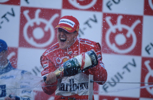 2004 Japanese Grand Prix. Suzuka , Japan 8th - 10th October 2004 Michael Schumacher, Ferrari F2004 celebrates his thirteenth win of the season. World Copyright:Steven Tee/LAT Photographic  Ref: 35mm Image: A24