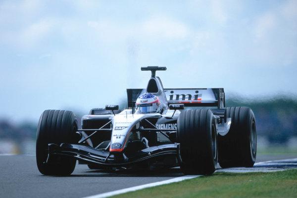 2004 British Grand PrixSilverstone England. 9th - 11th July.Kimi Raikkonen, McLaren Mercedes MP4/19. Action. World Copyright:Charles Coates/LAT Photographic Ref:35mm image A09