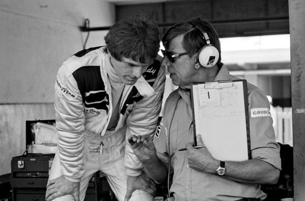 (L to R): Fourth placed Derek Daly (IRE) talks with Ken Tyrrell (GBR) Tyrrell Team Owner in the pits.