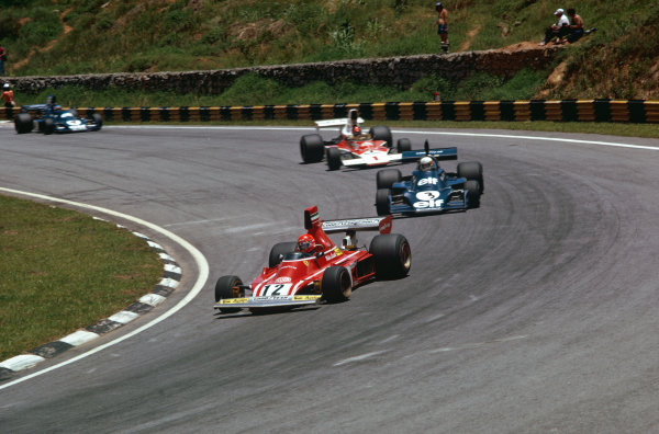1975 Brazilian Grand Prix  Interlagos, Sao Paulo, Brazil. 24-26th January 1975.  Niki Lauda, Ferrari 312B3, leads Jody Scheckter, Tyrrell 007 Ford, and Emerson Fittipaldi, McLaren M23 Ford.  Ref: 75BRA04. World copyright: LAT Photographic