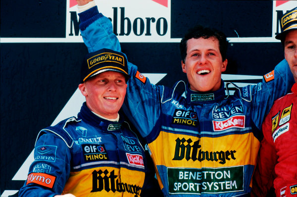 Barcelona, Spain.12-14 May 1995.Michael Schumacher, 1st position with teammate Johnny Herbert , 2nd position (both Benetton Renault) on the podium. Ref-95 ESP 01.World Copyright - LAT Photographic