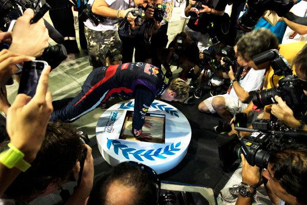 Yas Marina Circuit, Abu Dhabi, United Arab Emirates. Sunday 3rd November 2013. A plaster cast is made of the hands of winner Sebastian Vettel, Red Bull Racing. World Copyright: Charles Coates/LAT Photographic. ref: Digital Image _X5J7980