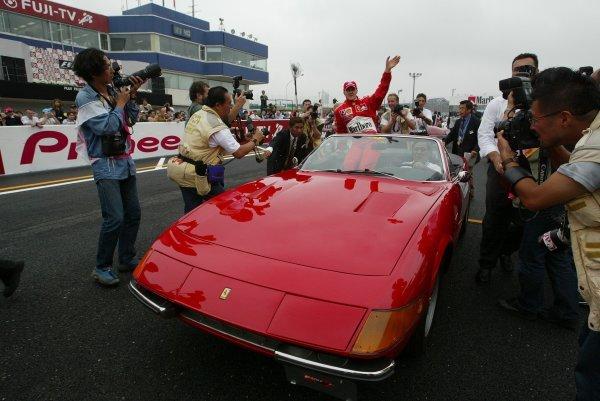 Michael Schumacher (GER) Ferrari takes to the drivers' parade in a Ferrari Daytona SpiderFormula One World Championship, Rd16, Japanese Grand Prix, Suzuka , Japan, 12 October 2003.DIGITAL IMAGE