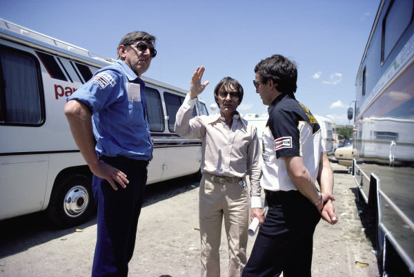 Ken Tyrrell, Bernie Ecclestone (Brabham team owner and FOCA spokesman) and Jackie Oliver, discussing issues between FISA and FOCA.
