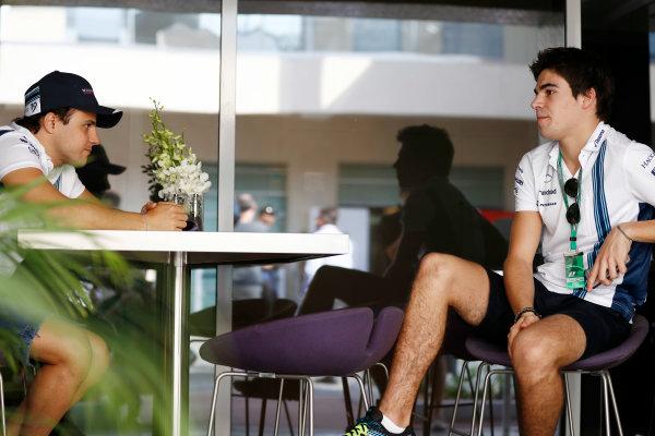 Yas Marina Circuit, Abu Dhabi, United Arab Emirates. Thursday 24 November 2016. Felipe Massa, Williams Martini Racing, with Lance Stroll, Williams F1. World Copyright: Glenn Dunbar/LAT Photographic ref: Digital Image _31I2590