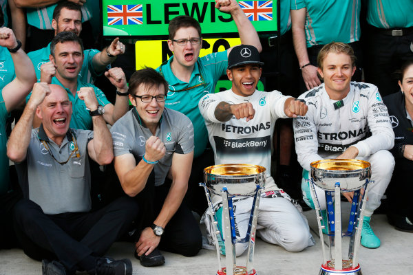 Circuit of the Americas, Austin, Texas, United States of America. Sunday 2 November 2014. Lewis Hamilton, Mercedes AMG, 1st Position, Nico Rosberg, Mercedes AMG, 2nd Position, and the Mercedes team celebrate victory. World Copyright: Charles Coates/LAT Photographic. ref: Digital Image _N7T5635