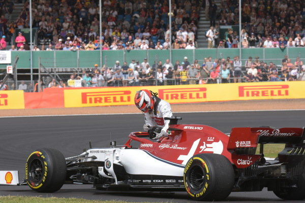 Kimi Raikkonen, Alfa Romeo Racing C38, climbs out of his car after stopping during practice