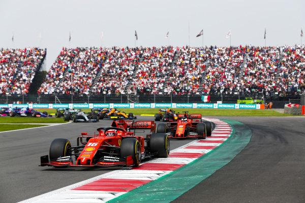 Charles Leclerc, Ferrari SF90 leading Sebastian Vettel, Ferrari SF90 at the start of the race
