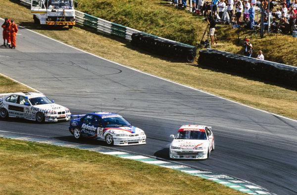 David Leslie, Honda Team MSD, Honda Accord, slides sideways ahead of Kelvin Burt, Valvoline Team Mondeo, Ford Mondeo Ghia, and David Brabham, BMW Motorsport Team, BMW 318i.