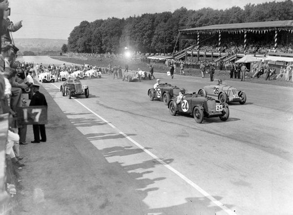 John Donald Barnes, Team Autosports, Singer 9 Le Mans Replica, leads Amedée Gordini, Simca Six Fiat, Norman Black, Singer 9 Le Mans Replica, and Tommy Wisdom, Singer Motors, Singer 9 Le Mans Replica, at the start.