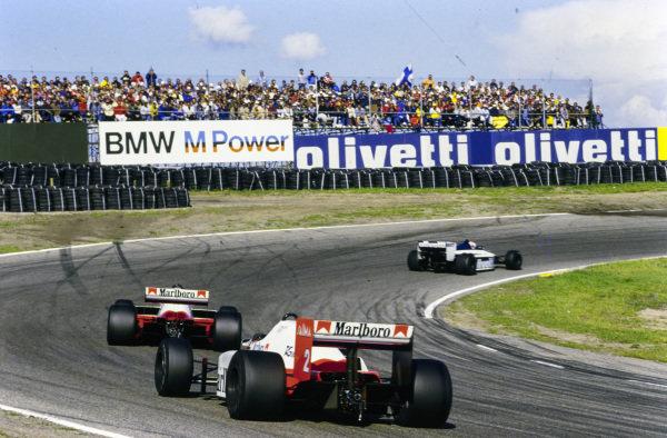 Nelson Piquet, Brabham BT54 BMW, leads Niki Lauda, McLaren MP4-2B TAG, and Alain Prost, McLaren MP4-2B TAG.