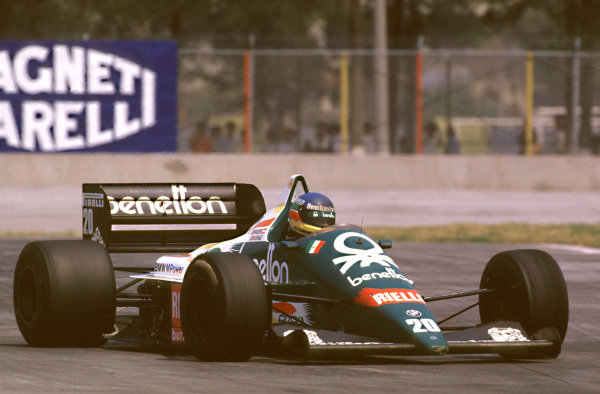 1986 Mexican Grand Prix.Mexico City, Mexico.10-12 October 1986.Gerhard Berger (Benetton B186 BMW) 1st position for his maiden Grand Prix win.World copyright - LAT Photographic