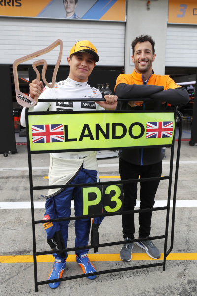 Lando Norris, McLaren, 3rd position, andDaniel Ricciardo, McLaren , celebrate with the McLaren team after the race