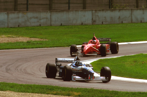 Imola, Italy.3-5 May 1996.Damon Hill (Williams FW18 Renault) followed by Michael Schumacher (Ferrari F310).Ref-96 SM 08.World Copyright - LAT Photographic