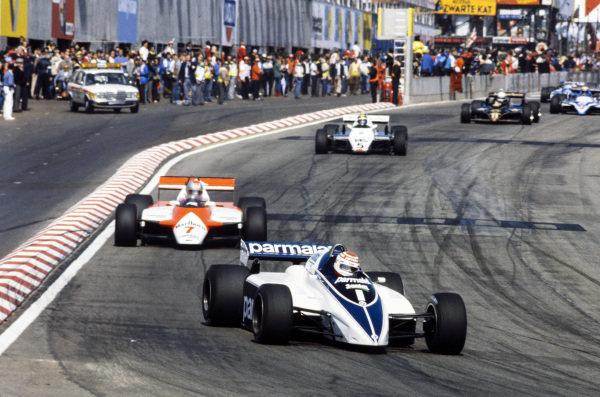 Nelson Piquet, Brabham BT50 BMW, leads John Watson, McLaren MP4-1B Ford, and Derek Daly, Williams FW08 Ford.