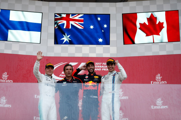 Baku City Circuit, Baku, Azerbaijan. Sunday 25 June 2017. Daniel Ricciardo, Red Bull Racing, celebrates victory on the podium with Valtteri Bottas, Mercedes AMG, and Lance Stroll, Williams Martini Racing.  World Copyright: Glenn Dunbar/LAT Images ref: Digital Image _X4I2952