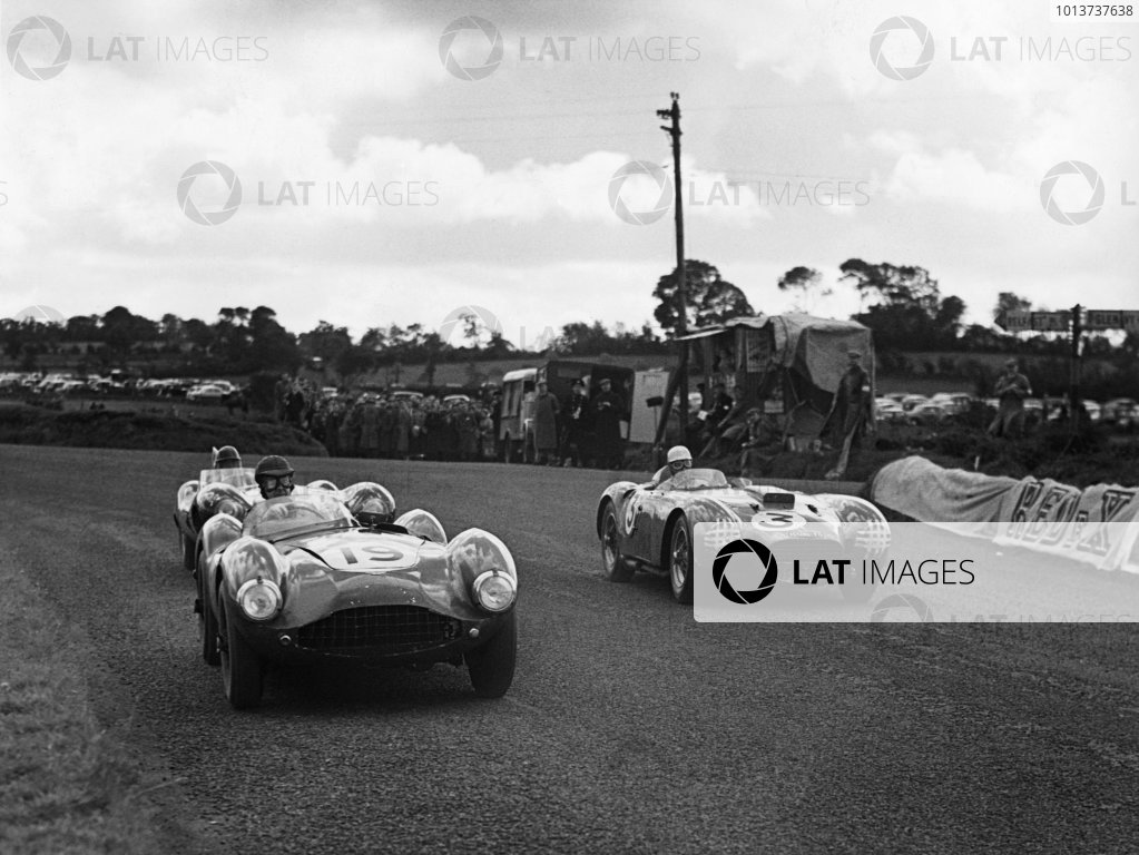 Dundrod, Northern Ireland. 11 September 1954 Graham Whitehead/Dennis Poore (Aston Martin DB3S), 8th position leads Piero Taruffi/Juan Manuel Fangio (Lancia D24), 2nd position,  action. World Copyright: LAT Photographic Ref: B/W Print