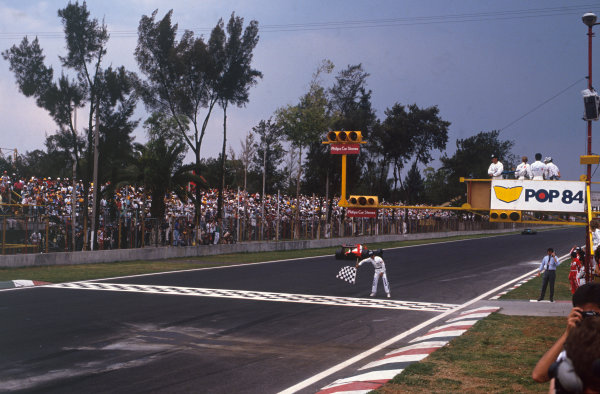 Mexico City, Mexico. 27th - 29th May 1988.Alain Prost (McLaren MP4/4 Honda), 1st position, crosses the line to take the victory, action. World Copyright: LAT Photographic.Ref:  88MEX