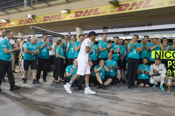 Bahrain International Circuit, Sakhir, Bahrain. Sunday 19 April 2015. Lewis Hamilton, Mercedes AMG, 1st Position, Nico Rosberg, Mercedes AMG, 3rd Position, and the Mercedes team celebrate victory. World Copyright: Steve Etherington/LAT Photographic. ref: Digital Image SNE24504