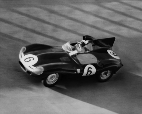 Monza, Italy. 29th June 1958. Ivor Bueb, Ecurie Ecosse D-Type Jaguar, 9th position. The race was also known as Monzanapolis, action. World Copyright: LAT Photographic. Ref: Autocar Used Pic Pg 17, 4th July 1958.