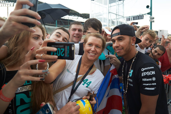 Hungaroring, Budapest, Hungary. Thursday 23 July 2015. Lewis Hamilton, Mercedes AMG, signs autographs for fans. World Copyright: Steve Etherington/LAT Photographic ref: Digital Image SNE11258