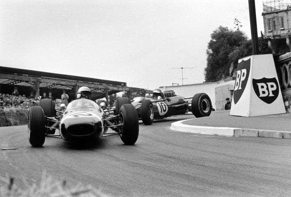 1965 Monaco Grand Prix.Monte Carlo, Monaco. 30 May 1965.Jo Bonnier, Brabham BT7-Climax, 7th position, leads Paul Hawkins, Lotus 33-Climax, 10th position, action.World Copyright: LAT PhotographicRef: L65/219/12A