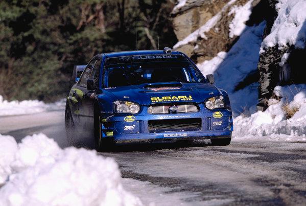 2003 FIA World Rally Championship. Monte Carlo, Monaco. Rd1.23-26 January 2003.Petter Solberg/Philip Mills (Subaru Impreza WRC '03).World Copyright: McKlein/LAT Photographicref: 35mm Image A21