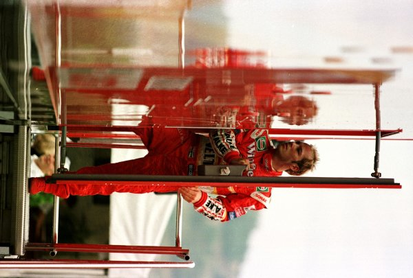 1998 Hungarian Grand Prix.Hungaroring, Budapest, Hungary.14-16 August 1998.Jacques Villeneuve (Williams Mecachrome) enters the team truck for his practice debrief.World Copyright - Steve Etherington/LAT Photographic