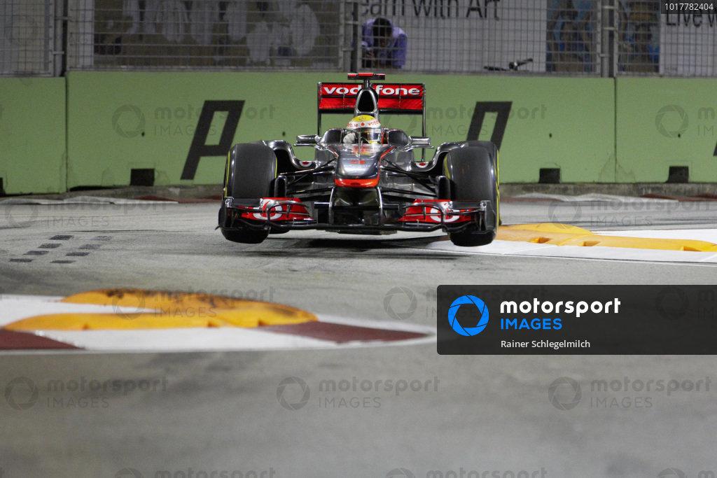 Lewis Hamilton, McLaren MP4-26 Mercedes, gets airborne at the Singapore Sling.