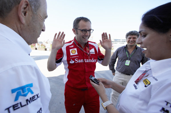 Stefano Domenicali jokes around with Peter Sauber and Monisha Kaltenborn.