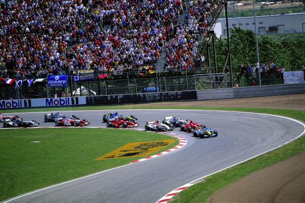 Jarno Trulli, Renault R24, leads Michael Schumacher, Ferrari F2004, Takuma Sato, BAR 006 Honda, Juan Pablo Montoya, Williams FW26 BMW, Rubens Barrichello, Ferrari F2004, and Fernando Alonso, Renault R24.