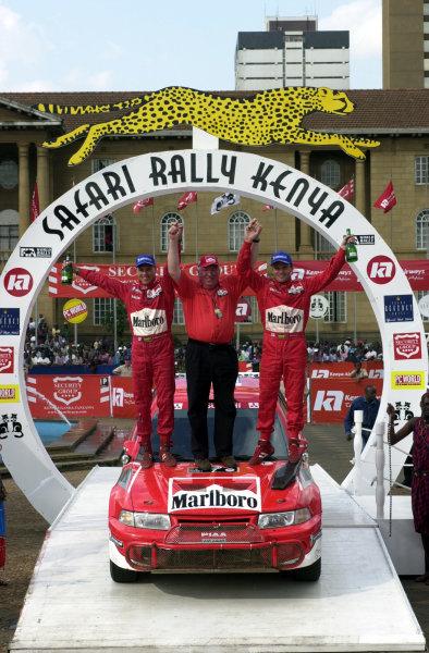 2001 World Rally Championship.Nairobi, Kenya. July 20-22, 2001Andrew Cowan celebrates with his Finnish crew.Photo: Ralph Hardwick/LAT