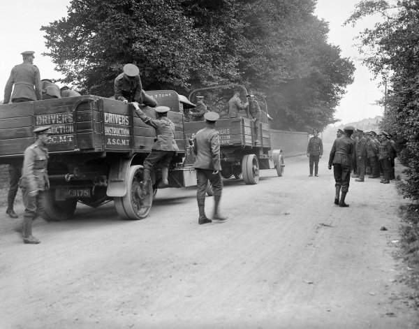 Recruits disembark from lorries during their training to become drivers, at the Army Service Corps Motor Transport Depot in Isleworth.