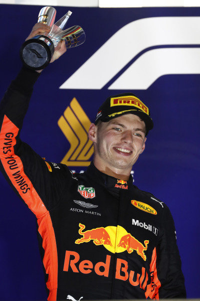 Max Verstappen, Red Bull Racing, 2nd position, lifts his trophy on the podium