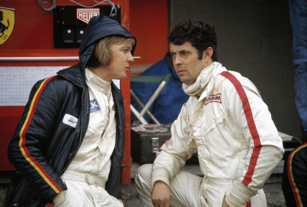 Ronnie Peterson chats with Ferrari team-mate Brian Redman in the pitlane.