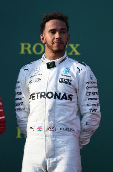 Lewis Hamilton (GBR) Mercedes AMG F1 on the podium at Formula One World Championship, Rd1, Australian Grand Prix, Race, Albert Park, Melbourne, Australia, Sunday 26 March 2017.