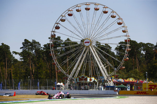 Esteban Ocon, Force India VJM11 Mercedes, leads a Ferrari.